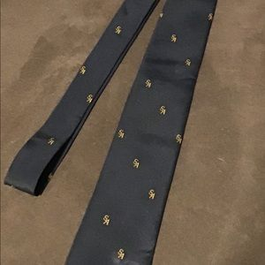 Tarrant Yoon Sung blue tie with SA pattern.